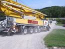 Autocar ACX Heavy  Truck Totes a Big Concrete Pump